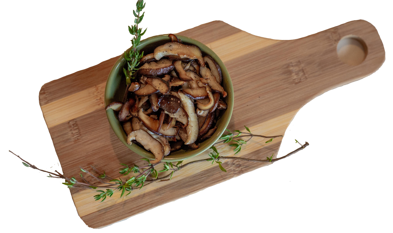 sauteed shiitake mushrooms on a cutting board